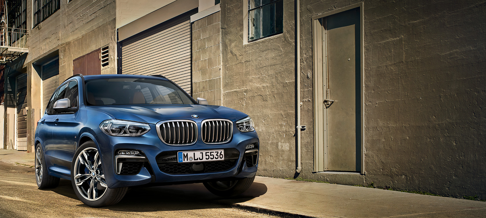 BMW X3 M40i, shot in front of house wall