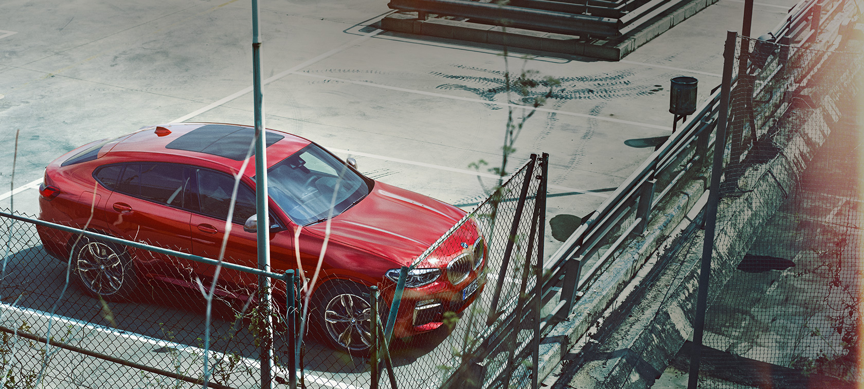 BMW X4 G02 2018 Flamenco Red brilliant effect parking on parking deck bird's eye view